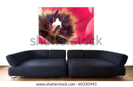 minimalistic living room with black couch and a flower fine photographic print - stock photo