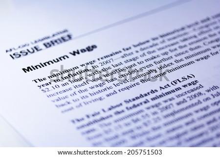 Minimum wage article close up - stock photo