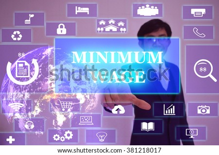 MINIMUM WAGE concept  presented by  businessman touching on  virtual  screen ,image element furnished by NASA - stock photo