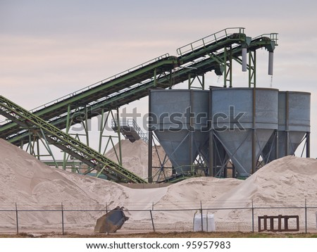 Mining belts are sorting sand - stock photo