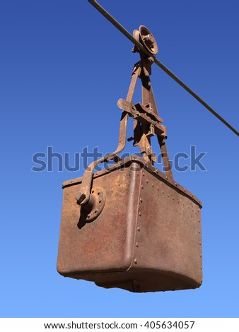 Mining Bucket suspended on a cable - stock photo