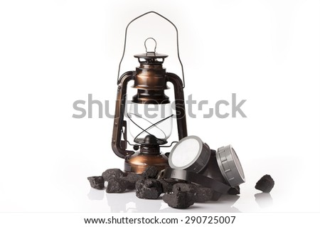 mining concept with oil lantern and protective ear lumps - stock photo