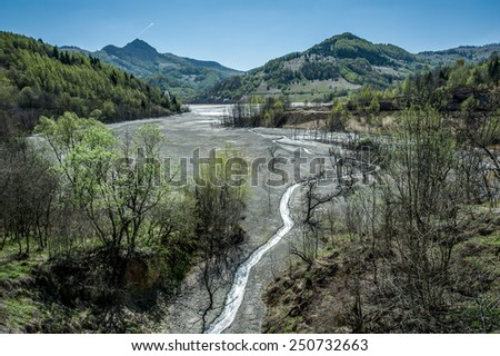 Mining disaster and water pollution in Romania. Mining disaster. Copper mine exploitation. - stock photo