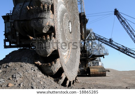 Mining equipment; closeup of a bucketwheel reclaimer, used at oil sands mines in Alberta, Canada - stock photo