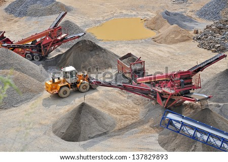 Mining machine, stone quarry. - stock photo