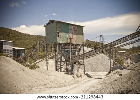 Mining machine, stone quarry ,Mining, Quarry, Limestone stock pile and reclaimer - stock photo