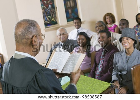 Minister Giving Sermon in Church - stock photo