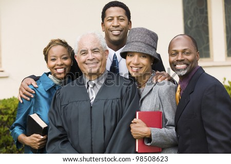 Minister with Family - stock photo