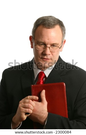 Minister with thoughtful expression - stock photo