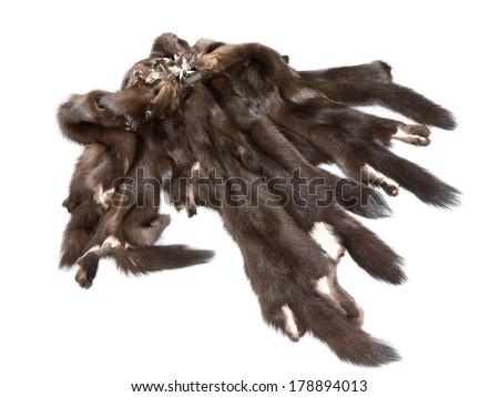 Mink skins  lying on white background - stock photo