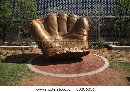 MINNEAPOLIS - APRIL 21: Classic baseball glove statue at Target Field, home of the Minnesota Twins, a ballpark that returns outdoor baseball to the city, on April 21, 2010 in Minneapolis, Minnesota. - stock photo