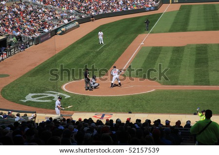 MINNEAPOLIS - APRIL 22: Jim Thome at the plate at new Target Field, home of the Minnesota Twins, a ballpark that returns outdoor baseball to the city, on April 22, 2010 in Minneapolis, Minnesota. - stock photo