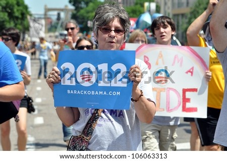 MINNEAPOLIS - JUNE 24:  A Barack Obama supporter marching in the Twin Cities Gay Pride Parade on June 24, 2012, in Minneapolis. - stock photo