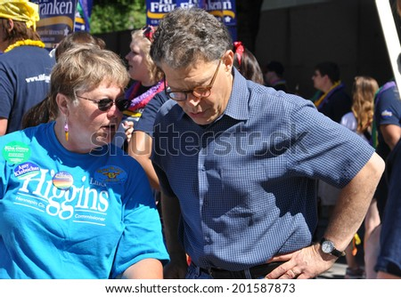 MINNEAPOLIS - JUNE 29: United States Senator Al Franken talking to a constituent at the Twin Cities Gay Pride Parade on June 29, 2014, in Minneapolis. - stock photo