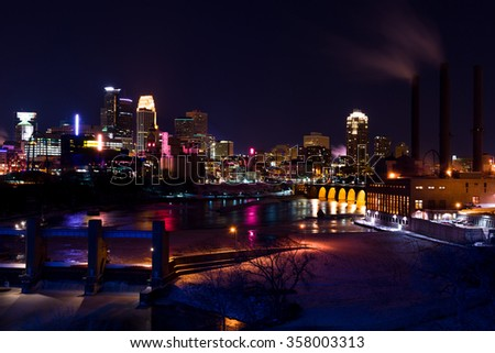 Minneapolis Minnesota Downtown Skyline Over the Mississippi River at Night - stock photo