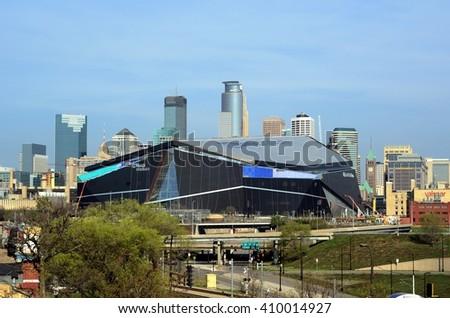 MINNEAPOLIS, MN - APRIL 23 2016: Minnesota Vikings US Bank Stadium in Minneapolis with Downtown Skyline - stock photo
