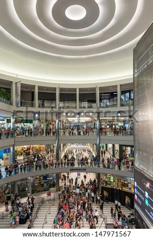 MINNEAPOLIS,MN - JULY 18: Mall of America, on July 18, 2013, in Minneapolis MN. The mall receives 40 million visitors annually, while the Minneapolis-St. Paul metro area only receives 18 million. - stock photo