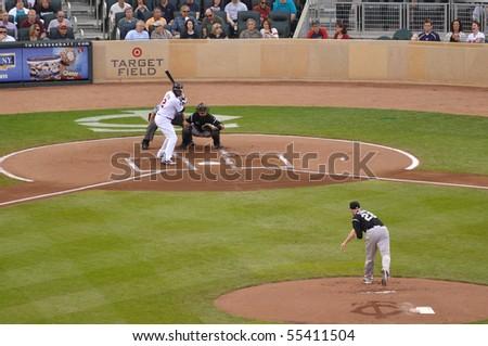 MINNEAPOLIS, MN - JUNE 15: Denard Span of the Minnesota Twins batting against Colorado Rockies pitcher Aaron Cook on June 15, 2010 in Minneapolis, MN - stock photo