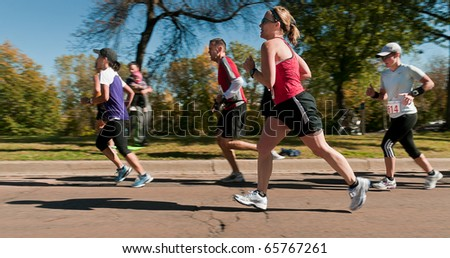 MINNEAPOLIS, MN - OCTOBER 3: Group of runners run up the hill of Mile 19 of the 2010 Medtronic Twin Cities Marathon, October 3, 2010 in Minneapolis, MN - stock photo