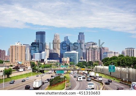 MINNEAPOLIS, MN, USA - JUNE 30 2016: Downtown Minneapolis Minnesota Skyline and Interstate Highway 35W - stock photo