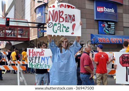 MINNEAPOLIS - SEPTEMBER 12: Health Care Reform protesters hold placards outside of Barack Obama's Health Care speech at the Target Center on September 12, 2009 in Minneapolis. - stock photo