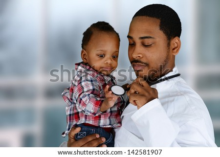 Minority male doctor working in a hospital - stock photo