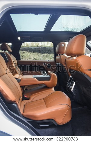 MINSK, BELARUS - APRIL 6, 2014: an interior of 2015 model year Range Rover Sport 3.0 Supercharged is on display. British SUV is powered by 3.0 liter V6 (340 hp & 450 Nm). Close up, shallof DOF. - stock photo