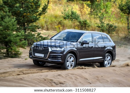 MINSK, BELARUS - AUGUST 28, 2015: 2015 model year all-new Audi Q7 3.0 TFSI goes off-road the test drive in Minsk, Belarus. Audi Q7 SUV is powered by 3.0 liter supercharged engine (333 hp). - stock photo