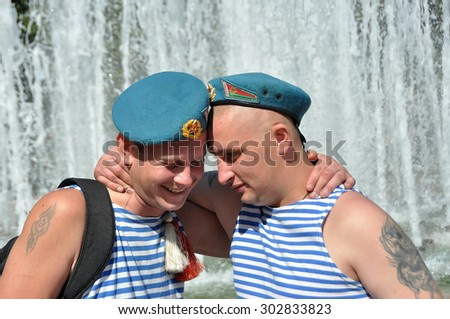 MINSK, BELARUS AUGUST 2, 2015: Unidentified paratroopers hugging near fountain during the celebration of the Paratroopers VDV Day on 2 August 2015 in Minsk. - stock photo