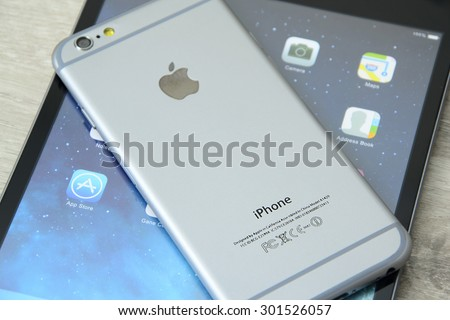 Minsk, Belarus - July 25, 2015: Apple iPad mini and  iPhone 6. A smaller version of the iPad. The operating system iOS. The founders: Steve Jobs, Steve Wozniak, Ronald Wayne. Apple Inc. located in USA - stock photo