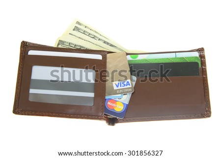 Minsk, Belarus - July 25, 2015: Wallet with Money and Bank Cards Visa, MasterCard. Location: US, Foundation Visa in 1970 the, Mastercard in 1966. - stock photo