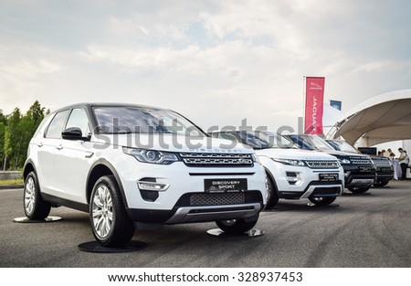 MINSK, BELARUS - JUNE 20, 2015: Test-drive event for 2015 model year Land Rover and Range Rover is held in Minsk, Belarus on June 20, 2015. British SUVs Land Rover Discovery Sport are on display. - stock photo