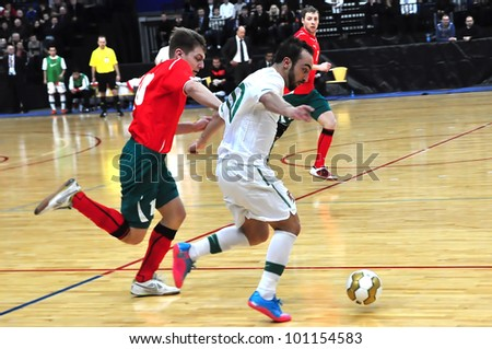 MINSK, BELARUS - MARCH 26: qualification World Cup 2012, Belarus � Portugal: Dribbling of the leader of Portugal Ricardinho (#10 ) on March 26, 2012 in Minsk, Belarus - stock photo