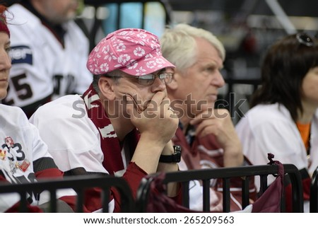 MINSK, BELARUS - MAY 17: Fan of Latvia during 2014 IIHF World Ice Hockey Championship match at Minsk Arena on May 17, 2014 in Minsk, Belarus. - stock photo