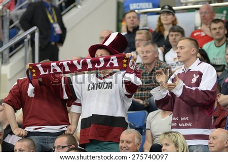 MINSK, BELARUS - MAY 20: Fans of Latvia during 2014 IIHF World Ice Hockey Championship match at Minsk Arena on May 20, 2014 in Minsk, Belarus. - stock photo