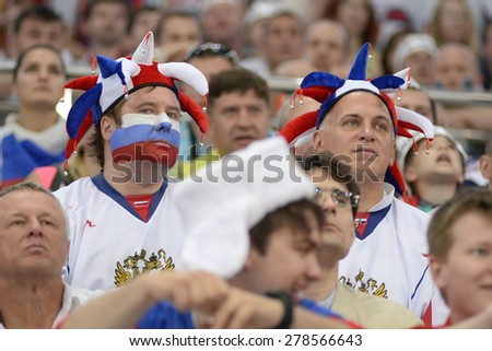 MINSK, BELARUS - MAY 24: Fans of Russia during 2014 IIHF World Ice Hockey Championship match at Minsk Arena on May 24, 2014 in Minsk, Belarus. - stock photo