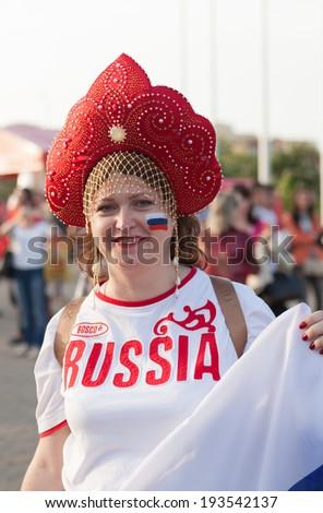 "MINSK, BELARUS - May 17, 2014: ICE HOCKEY WORLD CHAMPIONSHIP, MINSK-ARENA, The hockey fan from Russia with national accessories ""kokoshnik"" - stock photo"