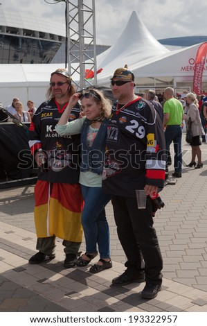MINSK, BELARUS - May 17, 2014: ICE HOCKEY WORLD CHAMPIONSHIP, MINSK-ARENA, The hockey fans from Germany with national flags in the in the uniform of a national team of Germany - stock photo