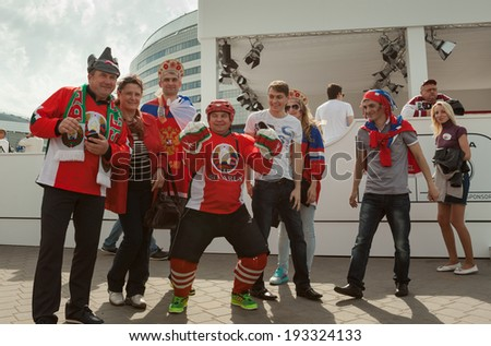 MINSK, BELARUS - May 17, 2014: ICE HOCKEY WORLD CHAMPIONSHIP, MINSK-ARENA, The hockey fans from Russia and Belarus with national accessories in the uniform of theirs national teams - stock photo