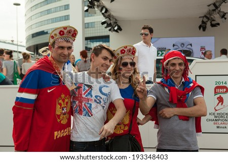 """MINSK, BELARUS - May 17, 2014: ICE HOCKEY WORLD CHAMPIONSHIP, MINSK-ARENA, The hockey fans from Russia with national accessories """"kokoshnik"""" in the uniform of theirs national team - stock photo"""