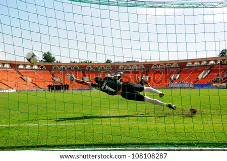MINSK, BELARUS MAY 20: Unidentified player (FC NAFTAN) scores a penalty in the Artur Lesko�s gates during final cup match between FC NAFTAN and FC MINSK on May 20, 2012 in Minsk, Belarus - stock photo