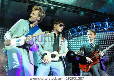 "MINSK, BELARUS NOVEMBER 6, 2010: ""A-ha"" band (Morten Harket, Paul Waaktaar-Savoy, Magne Furuholmen) performs during the live concert in Minsk on November 6, 2010 - stock photo"