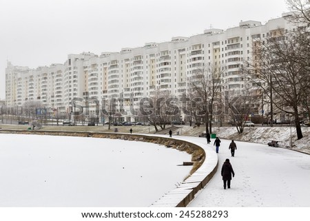 MINSK, BELARUS - NOVEMBER 26, 2014: People walking at the streets covered by the snow  in Minsk, Belarus.  - stock photo