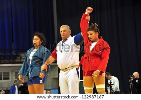 MINSK, BELARUS - NOVEMBER 10: Prischepa UKR (red) wins gold medal during SAMBO (Wrestling) WORLDCh-2012 on November 10, 2012 in Minsk, Belarus. - stock photo