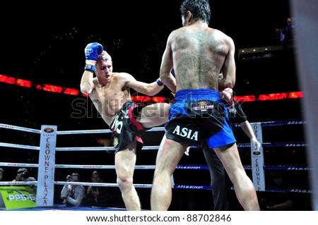 MINSK, BELARUS-SEPT. 12: Andrej Kulebin of Belarus kick VS Sudsakorn Klinmi of Asia (right) in final fight of BIG8 MUAY-THAY CHAMP in Minsk, Belarus on September 12, 2010 - stock photo