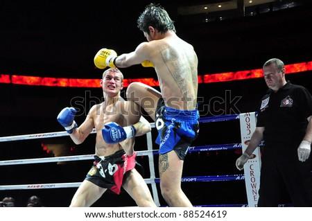 MINSK, BELARUS-SEPT. 12: Andrej Kulebin of Belarus (left) VS Sudsakorn Klinmi of Asia (right) in final fight of BIG8 MUAY-THAY CHAMP in Minsk, Belarus on September 12, 2010 - stock photo
