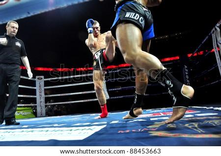 MINSK, BELARUS-SEPTEMBER 12:Andrej Kulebin (left) from Belarus VS Taylor Harvey (right) from Australia fight at BIG8 MUAY-THAY CHAMP in Minsk, Belarus on September 12, 2010 - stock photo