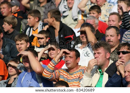 MINSK, BELARUS - SEPTEMBER 13: Match DYNAMO minsk VS TORPEDO Jodino, soccer fans watching match on September 13,2009 in Minsk, Belarus - stock photo