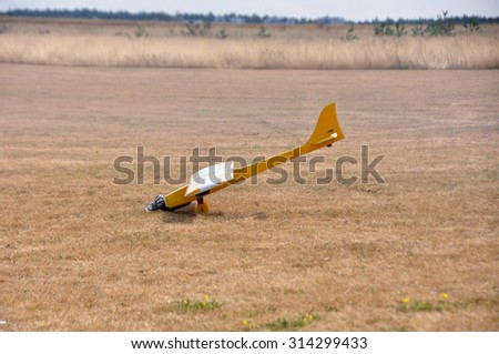 """MINSK, BELARUS â?? SEPTEMBER 5 Model of airplane is crashing on the """"USSR Cup 2015"""" (Competition racing radio-controlled model classes F3D and Q500) on September 5, 2015 in Minsk, Belarus. - stock photo"""