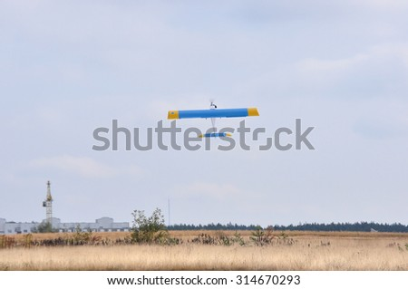 """MINSK, BELARUS SEPTEMBER 5 Model of airplane is taking-off on the """"USSR Cup 2015"""" (Competition racing radio-controlled model classes F3D and Q500) on September 5, 2015 in Minsk, Belarus. - stock photo"""